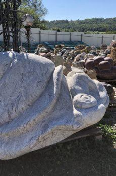 Каменная статуя Огромная улитка